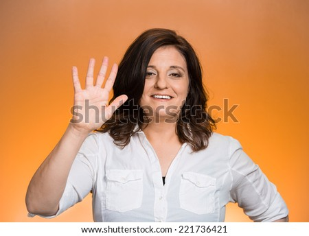 Closeup portrait, happy, smiling young woman making five times sign gesture with hand fingers, isolated orange background. Positive human emotion facial expression feelings, attitude, symbol, reaction - stock photo