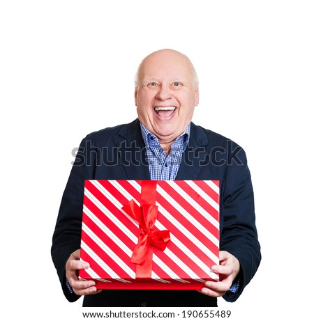 Closeup portrait, happy super excited senior man, opened, unwrapped red gift box, isolated white background, enjoying his present. Positive human emotion, facial expression, feeling attitude, reaction