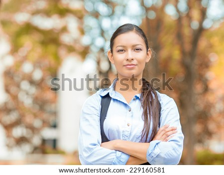 Closeup portrait, happy, young beautiful business woman professional in blue shirt smiling isolated outdoors outside indian fall background with park trees. Positive human emotions, facial expressions - stock photo