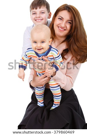 Closeup portrait happy young mama with little child and infant sitting on the floor - isolated on white background. Concept of young happy family. Focus on infant - stock photo