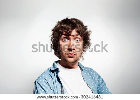 Closeup portrait happy young man, looking shocked, surprised in full disbelief isolated grey background. Positive human emotions, facial expressions, feeling, attitude, reaction - stock photo