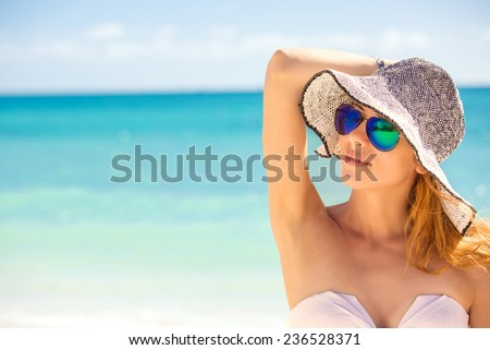 Closeup portrait happy young woman on the beach, beautiful female enjoying tropical sunny weather, pretty healthy girl relaxing outside, nature fun joy, spa, travel, paradise getaway, vacation concept - stock photo
