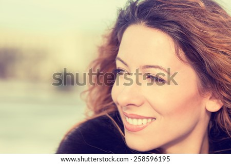 Closeup Portrait headshot Beautiful Young Woman Outdoors. Retro Instagram style warm filter picture - stock photo