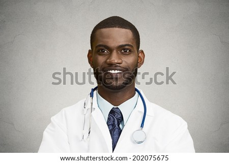 Closeup portrait, headshot happy confident male health care professional, dentist, pharmacist, scientist, researcher, doctor with stethoscope looking at you, isolated black background. Face expression - stock photo
