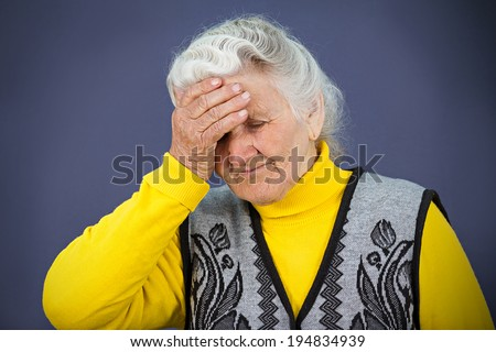 Closeup portrait, headshot sad alone dark gloomy, frustrated, stressed senior mature woman having bad headache, nightmare day isolated blue background. Negative human emotion facial expression feeling - stock photo