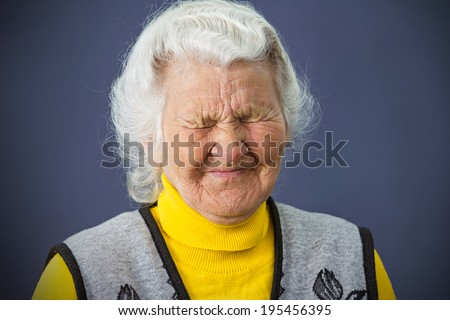 Closeup portrait, headshot, senior, elderly sad, depressed, lonely woman, grandmother crying, isolated dark blue background. Human facial expressions, emotions, reaction, life perception, mood - stock photo
