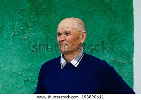 Closeup portrait, headshot senior, mature, elderly man, old sad guy, troubled, deep thought isolated green background. Human emotion, facial expressions, life perception, aging, depression, loneliness - stock photo