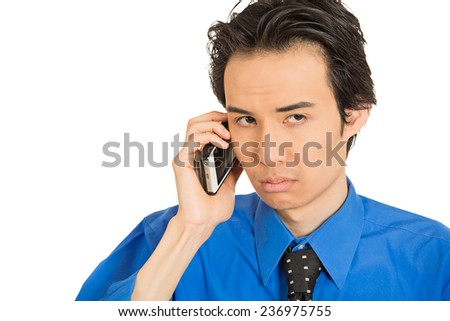 Closeup portrait headshot upset depressed worried young man student worker talking on mobile phone isolated white background. Human face expression emotion feeling reaction body language perception - stock photo