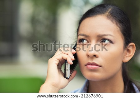 Closeup portrait, headshot upset sad, skeptical, unhappy, serious woman talking on cell phone isolated outdoor background. Negative human emotions, facial expression, feelings, life reaction. Bad news - stock photo