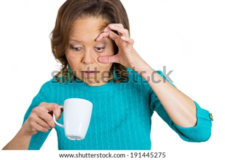 Closeup portrait, headshot very tired, falling asleep old woman, holding cup coffee, struggling not crash, stay awake, keeping eyes opened, isolated white background. Human face expressions, feelings - stock photo