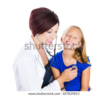 Closeup portrait, health care professional, pediatrician, nurse listening to heart and lungs exam of child with stethoscope, isolated white background. Patient visit, appointment checkup - stock photo
