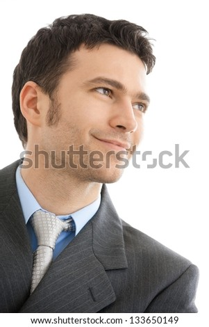Closeup portrait if smiling businessman wearing grey suit and tie. Looking away, smiling. Isolated on white background. - stock photo