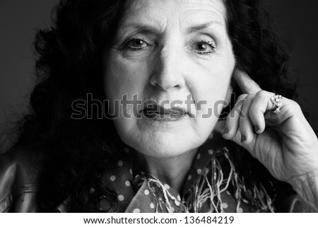 Closeup Portrait in Black and White of a Pretty Older Woman - stock photo