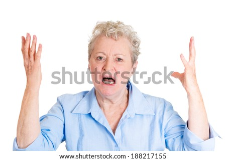 Closeup portrait, mad, angry, upset, hostile, senior mature woman, worker, furious employee, yelling, screaming, hands in air, isolated white background. Negative emotions, facial expression reaction - stock photo