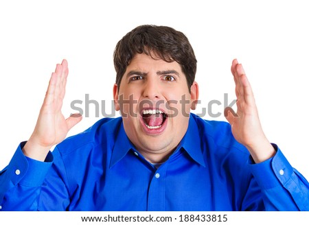Closeup portrait, mad, upset, young, funny looking business man, hands in air, open mouth yelling, isolated white background. Negative human emotion facial expression, reaction - stock photo