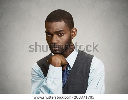 Closeup portrait man with sad expression, isolated on grey, black background. Human emotions, body language, life perception - stock photo