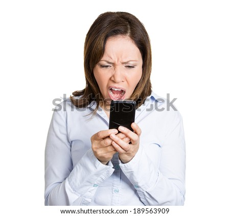 Closeup portrait, mature, shocked, business woman, corporate employee looking at cell phone, seeing a bad text message or email, isolated white background. Negative emotion facial expression - stock photo