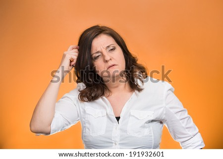 Closeup portrait middle age woman scratching head, thinking daydreaming deeply about something, looking sideways, isolated orange background. Human facial expression, emotion, feelings, signs symbols - stock photo