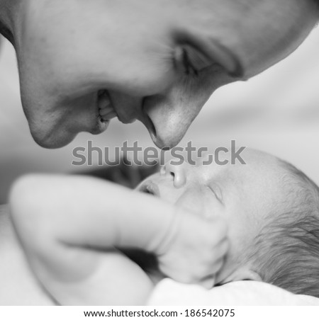 Closeup Portrait Mother and a newborn baby boy, 11 day old. Black-and-white photo - stock photo