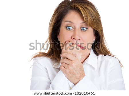 Closeup portrait  nervous middle age woman biting fingernails craving for something, anxious isolated white background. Negative human emotions, facial expressions, feelings, reaction life perception - stock photo