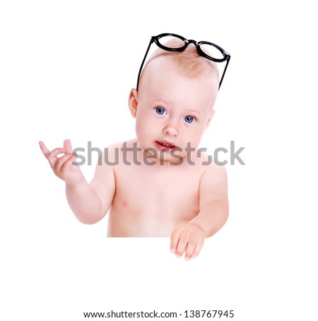 Closeup portrait of a baby boy wearing glasses oh forehead holding the blank board - stock photo