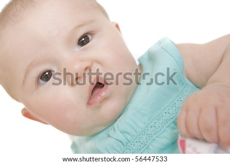 Closeup portrait of a baby girl making a funny face - stock photo
