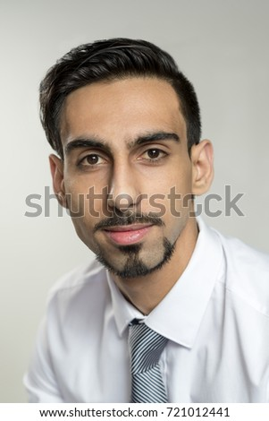 Closeup portrait of a bearded young man in business attire