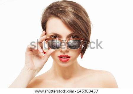 Closeup portrait of a beautiful girl with clean fresh skin, sunglasses and red lipstick