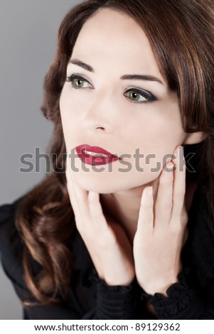 Closeup portrait of a beautiful green eyes red lips perfcet skin  woman looking away - stock photo