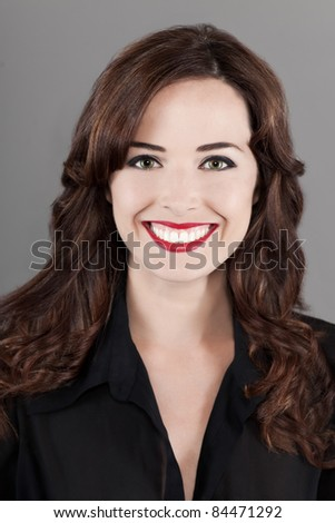 Closeup portrait of a beautiful happy brown haired woman toothy smiling isolated on gray background - stock photo