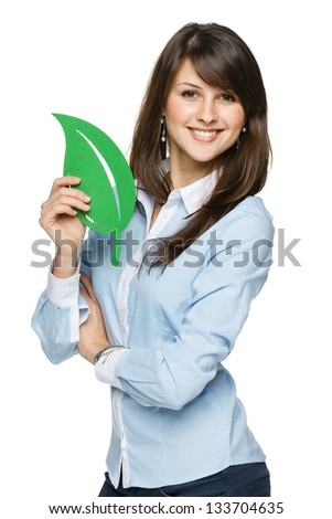 Closeup portrait of a beautiful happy young woman holding eco leaf - stock photo