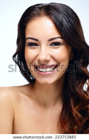 Closeup portrait of a beautiful laughing woman