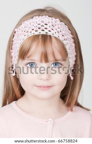 closeup portrait of a beautiful little smiling girl - stock photo