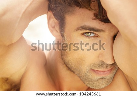 Closeup portrait of a beautiful male model - stock photo