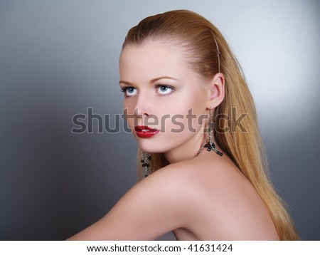 Closeup portrait of a beautiful model with red lips - stock photo