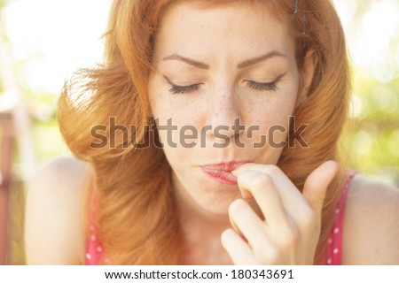 Closeup portrait of a beautiful pinup girl tasting dessert with her ayes closed, selective focus - stock photo