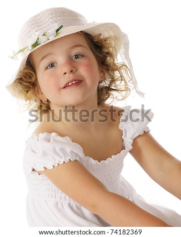 Closeup portrait of a beautiful preschooler in a white dress and Easter bonnet. - stock photo