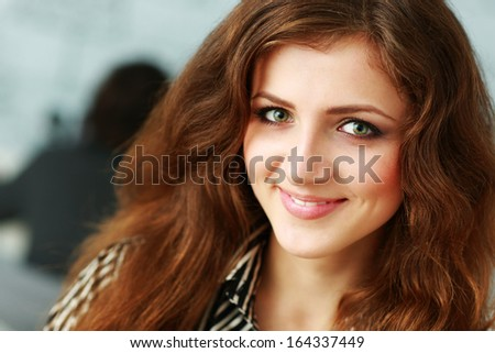 Closeup portrait of a beautiful smiling redhead woman