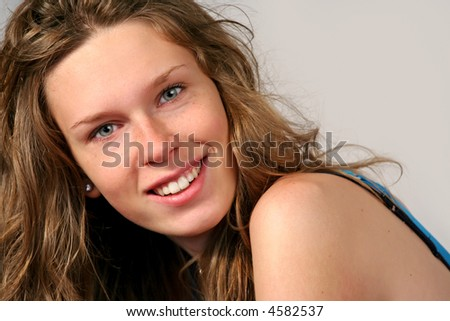 closeup portrait of a beautiful teenager girl smiling