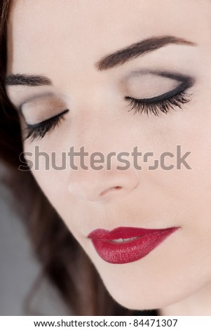 Closeup portrait of a beautiful woman eyes closed and red lips close up - stock photo