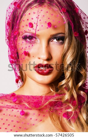 Closeup portrait of a beautiful woman in a pink veil