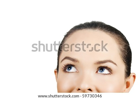 Closeup portrait of a beautiful woman looking up at copyspace. Isolated on white background. - stock photo