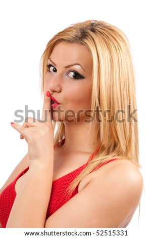 Closeup portrait of a beautiful woman making silence sign