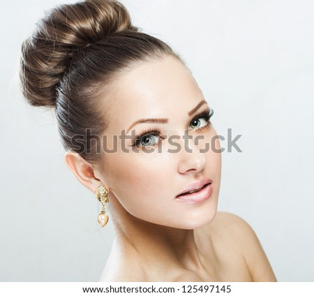 closeup portrait of a beautiful woman with beauty face and clean face skin , glamour makeup - stock photo