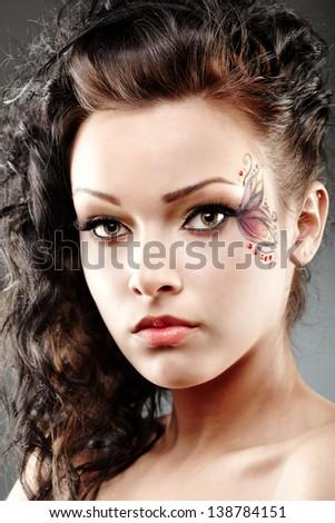 Closeup portrait of a beautiful woman with fantasy makeup - stock photo