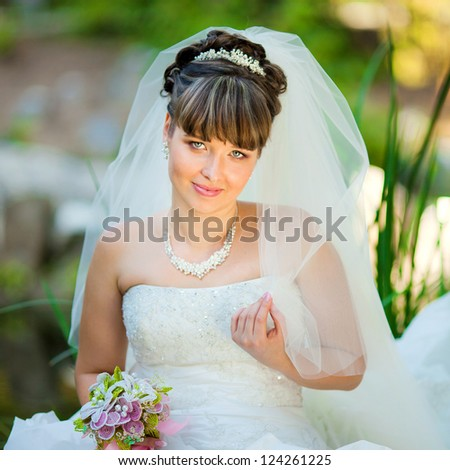 Closeup portrait of a beautiful young bride on their wedding day - stock photo