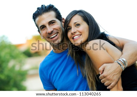 Closeup portrait of a beautiful young couple smiling together