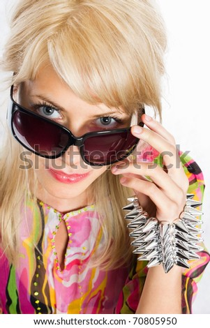 Closeup portrait of a beautiful young female fashion wearing sunglasses and spike bracelet - stock photo