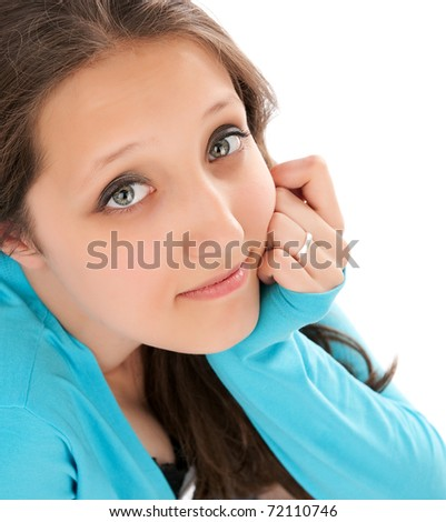 Closeup portrait of a beautiful young girl looking an camera - stock photo