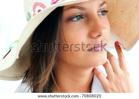 Closeup portrait of a beautiful young lady lost in deep thought - stock photo
